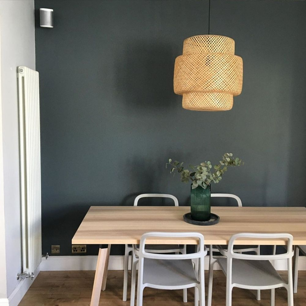 vertical column radiator in a scandi style dining room