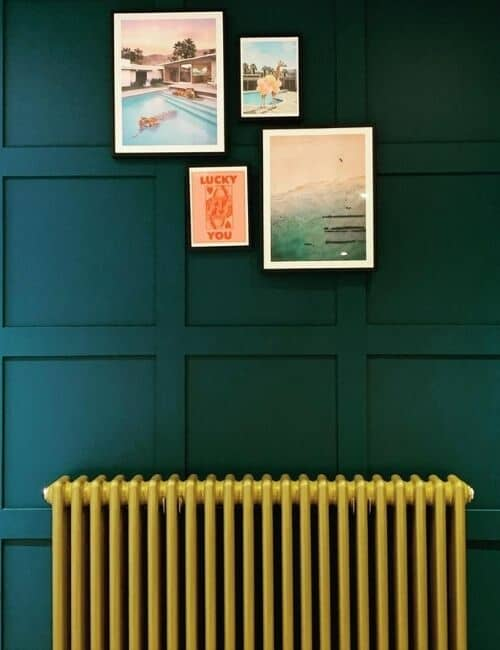 gold radiator on a green wall