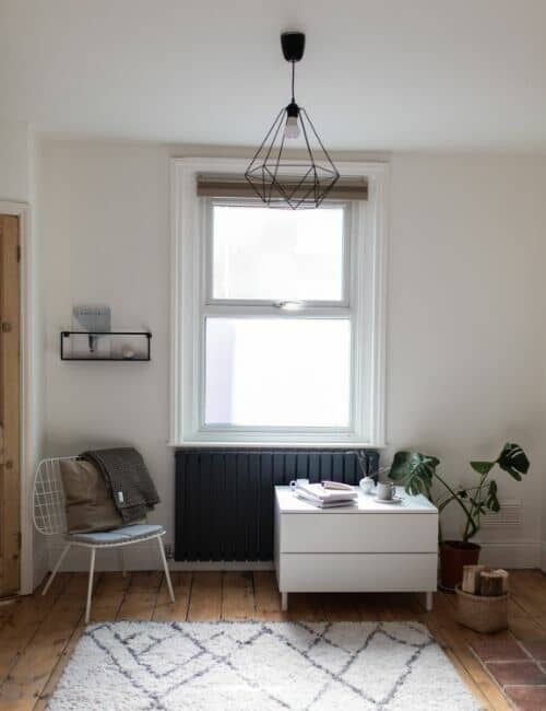 anthracite designer radiator in a minimal living room