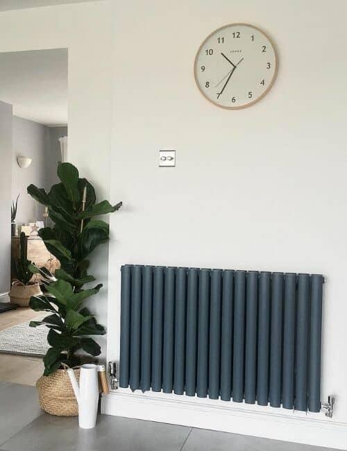 anthracite designer radiator on a white wall