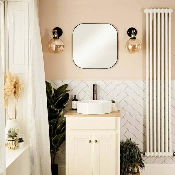 white vertical radiator in a modern bathroom