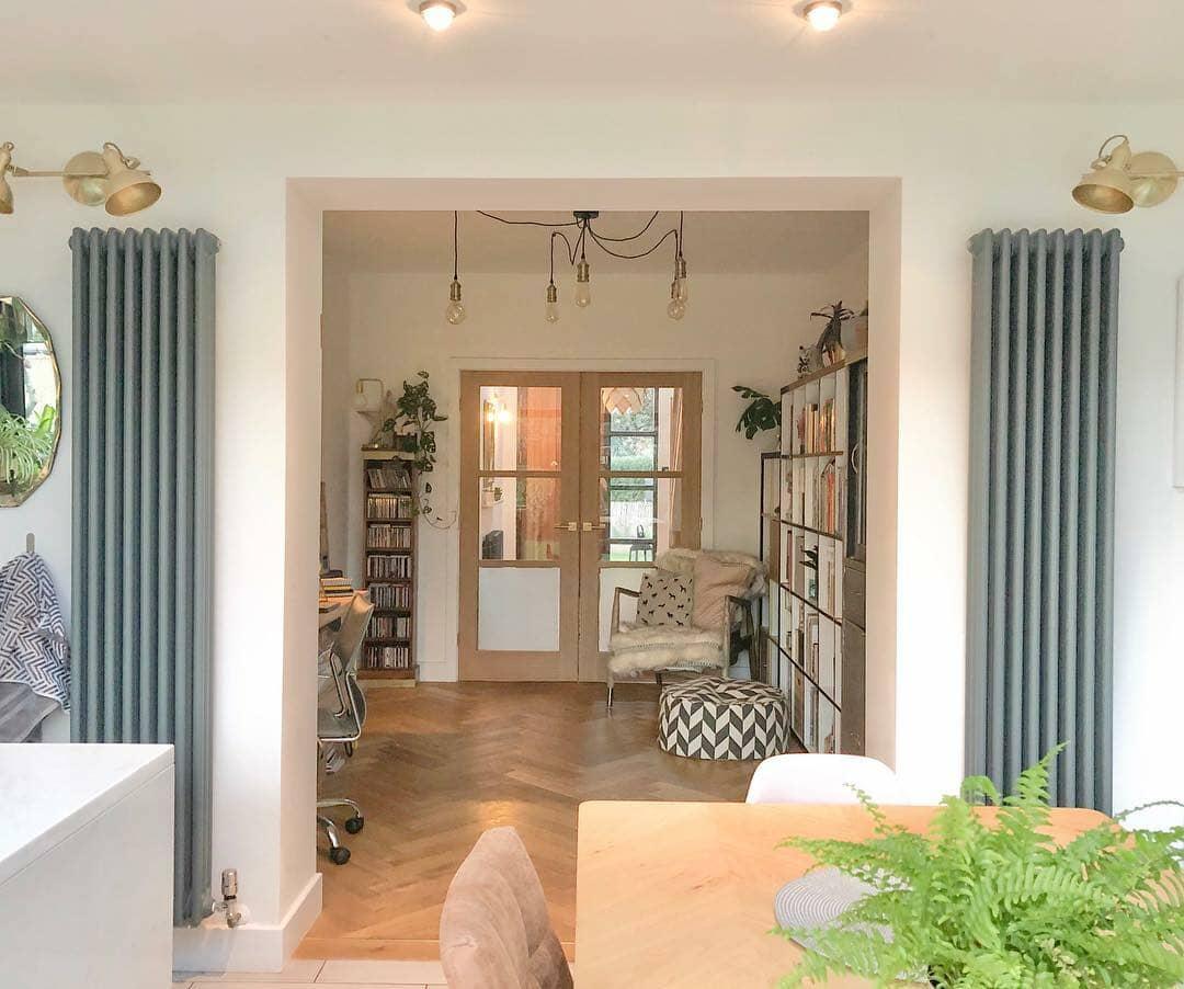 2 vertical radiators beside a doorway