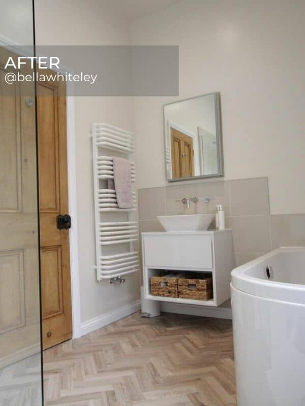 modern scandi style bathroom with a white heated towel rail