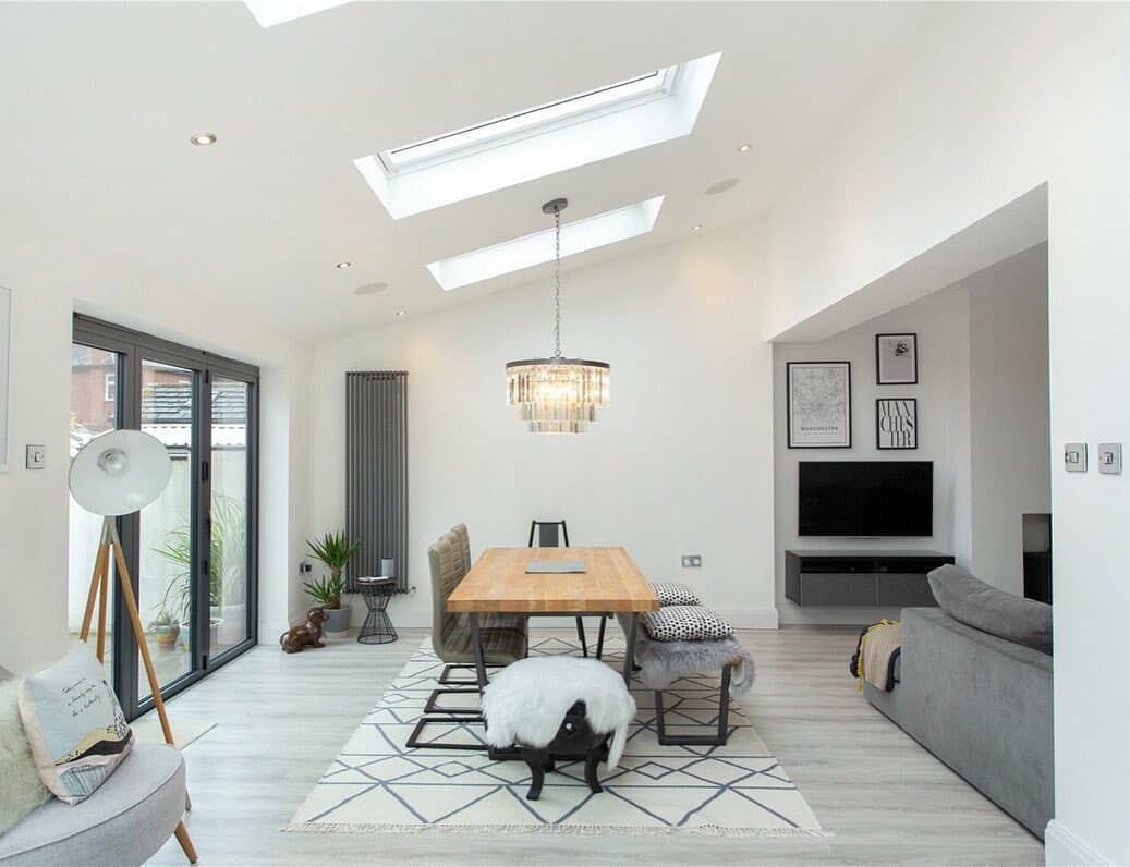grey vertical radiator in a white living space
