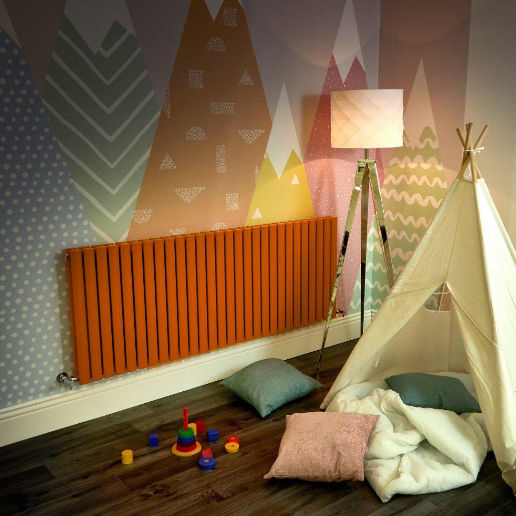 orange Milano Aruba radiator in a playroom