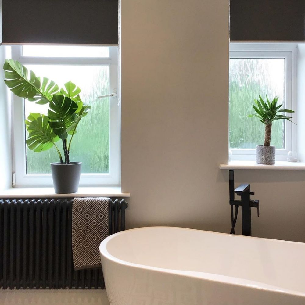 anthracite column radiator in a bedroom