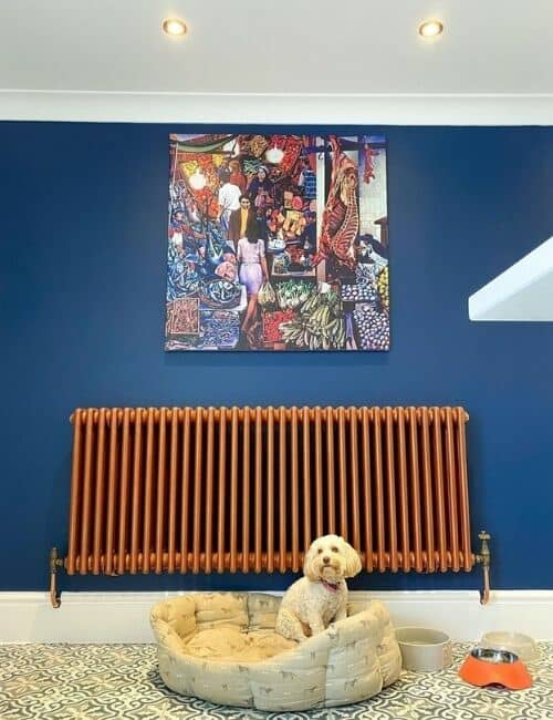 copper radiator on a blue wall