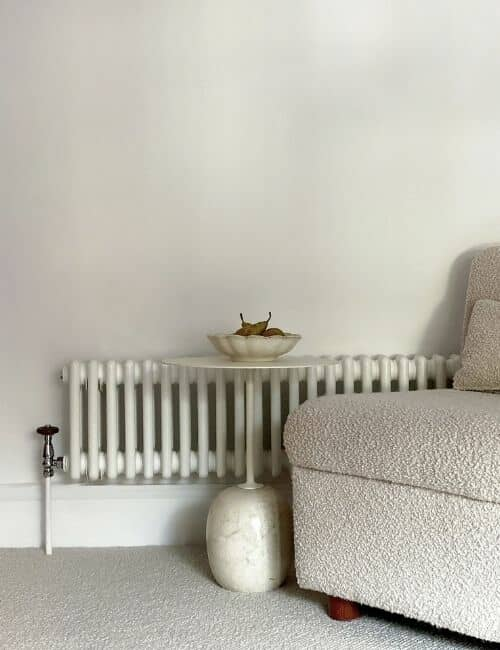 low level column radiator on a white wall