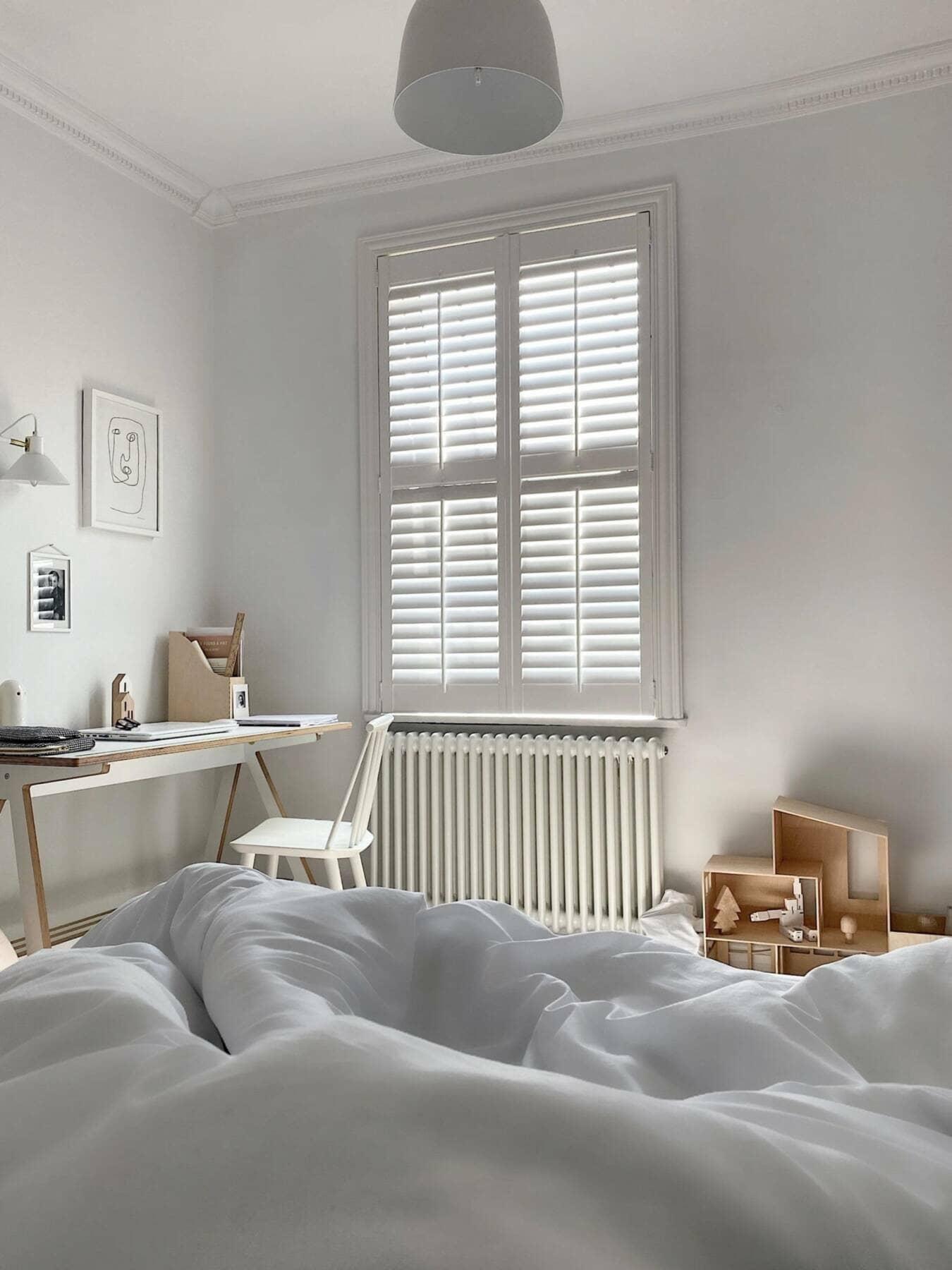 jonnie's bedroom with a radiator under the window