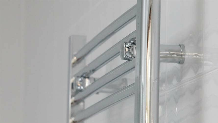 heated towel rail from the side, showing the depth from the wall