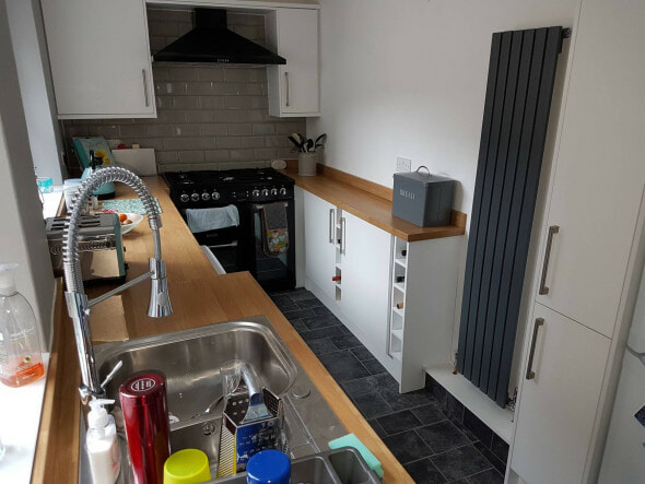 Milano Capri designer radiator in a galley kitchen in grey