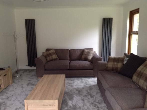 Double Vertical Designer Radiators placed on a wall in a sitting room making loads of space