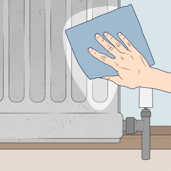 close up of person cleaning a radiator with a cloth