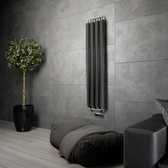 A Terma Ribbon radiator on a wall in grey
