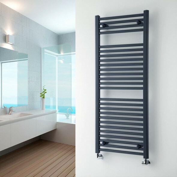 Grey heated towel rail on a wall in a bathroom