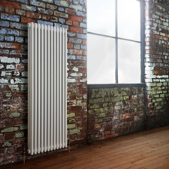 Milano Windsor Traditionally styled vertical radiator on an industrial style wall