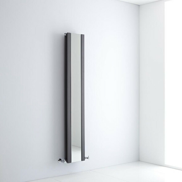 Mirrored vertical radiator on a white wall