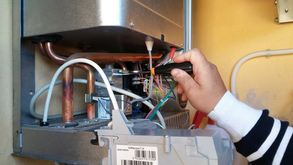 Gas central heating boiler being serviced