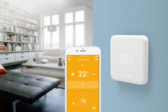 Tado smart app being used with a tado smart thermostat in a living room