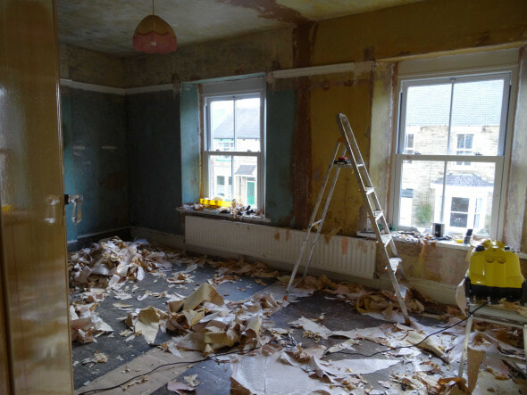 a room covered in wallpaper ready to be decorated