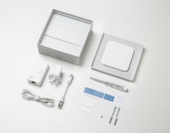 The tado smart thermostat box contents spread out on a table so each of the components are visible