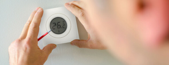 man installing the genius home thermostats SMART hub