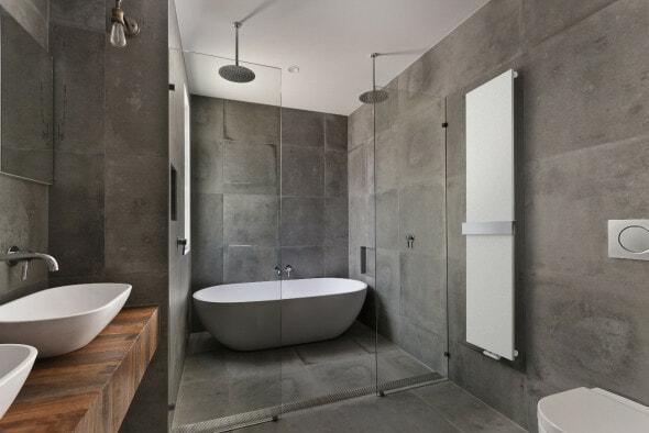 Lazzarini Ischia heated towel rail on a wall in a modern bathroom suite
