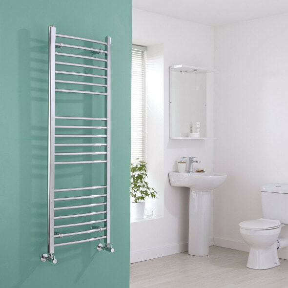 Milano Eco Curved Heated Towel Rail on a wall in a bathroom