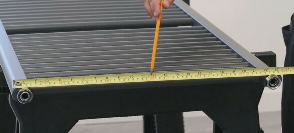 a tape measure being used to measure a heated towel rail