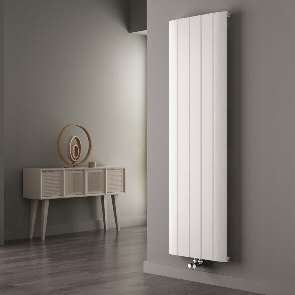 White Milano Skye Aluminium radiator on a wall in a hallway with a table in the background
