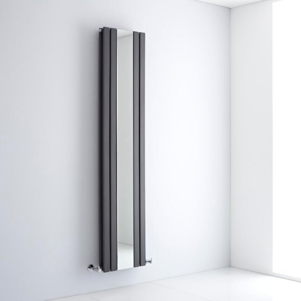 A milano icon vertical designer radiator on a wall in a bathroom