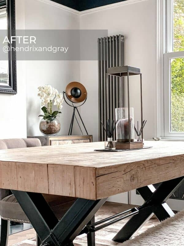 vertical raw metal column radiator in an industrial style dining room