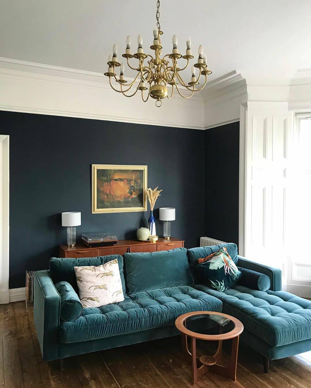 green velvet sofa in a luxury living room