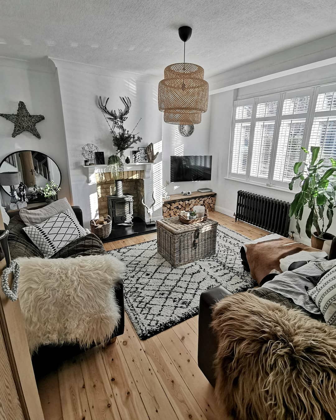 rustic living room with a grey column radiator