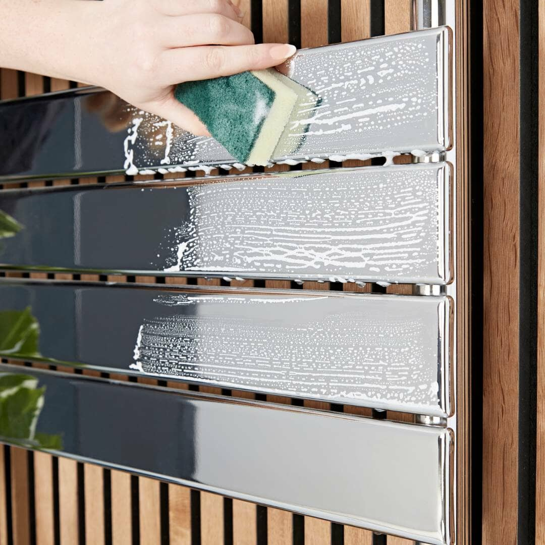 cleaning a chrome radiator with a sponge