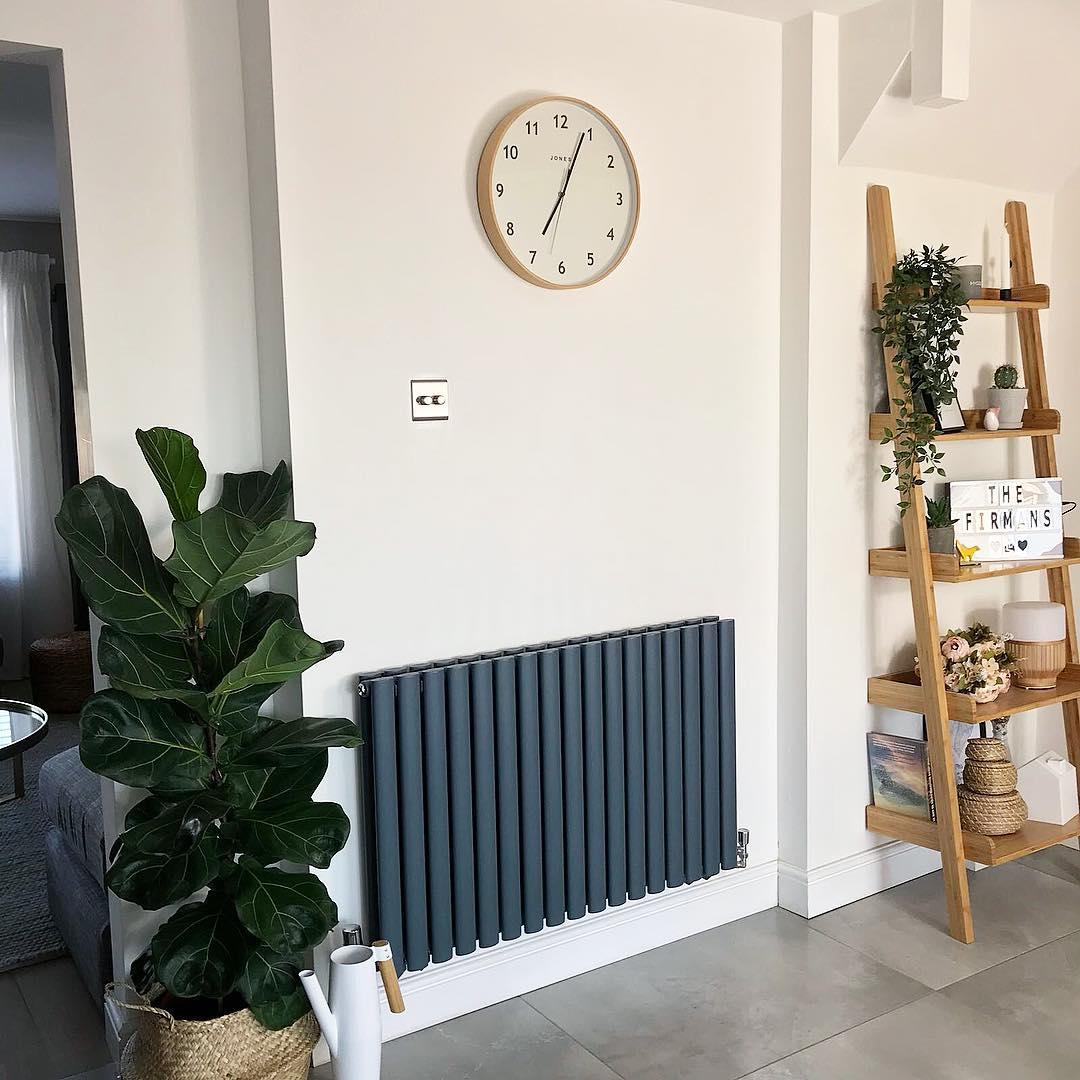 Milano Aruba anthracite radiator on a white wall