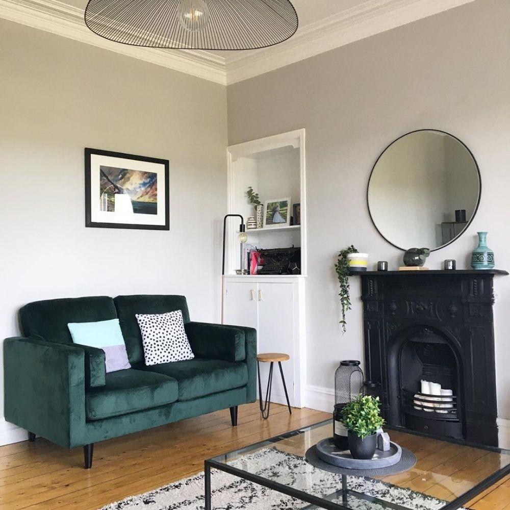 velvet sofa in a scandi style living room