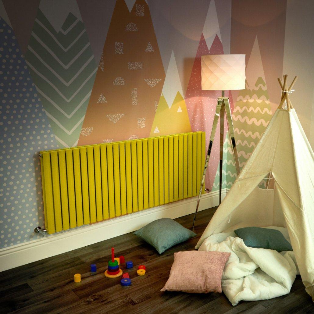 yellow Milano Aruba radiator in a playroom