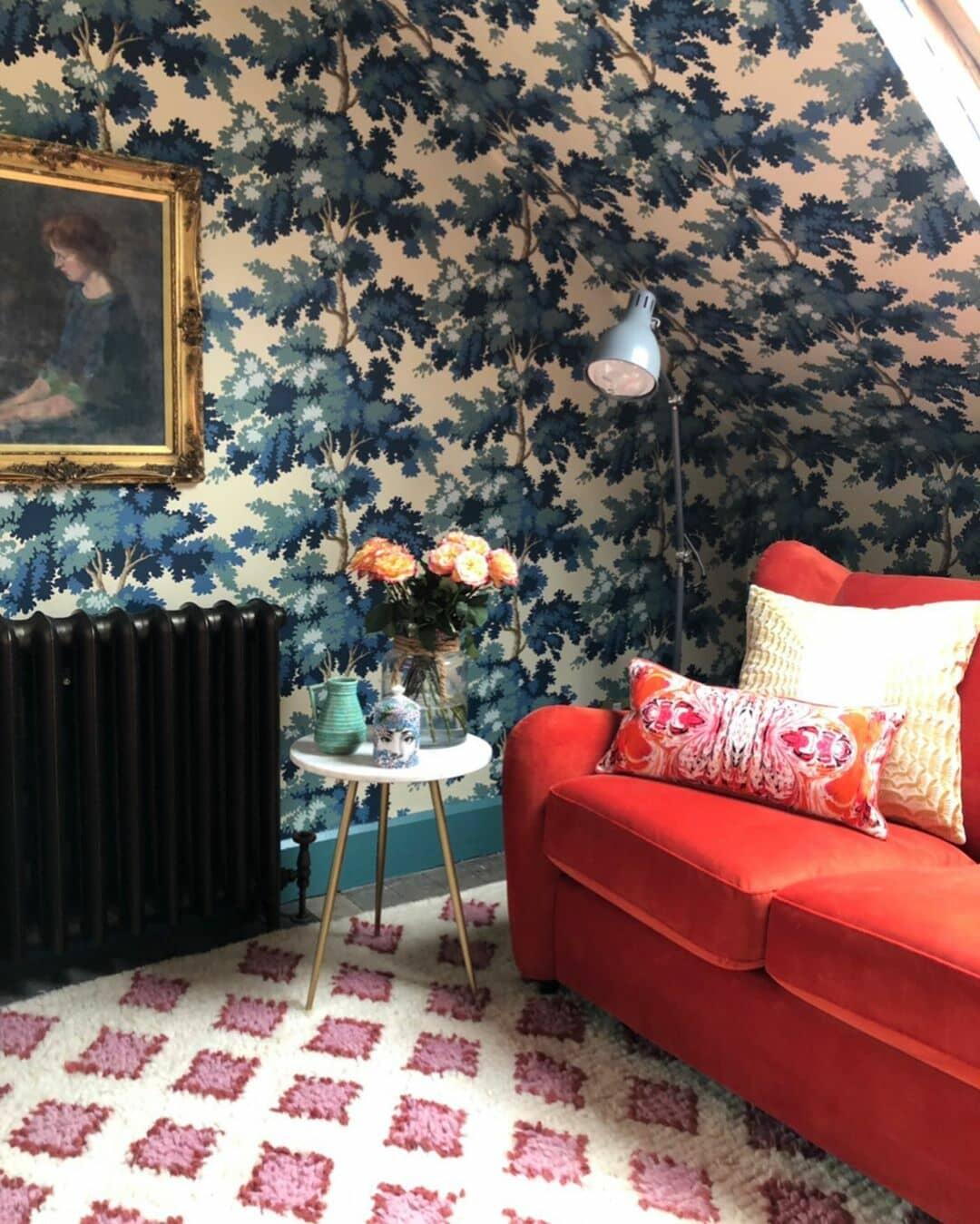 cast iron radiator on blue floral wallpaper