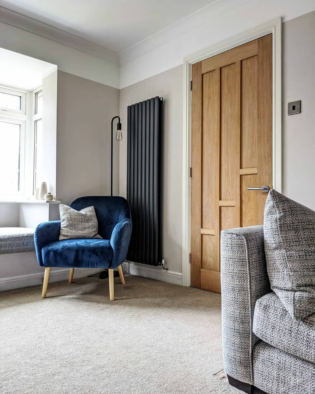 anthracite vertical radiator in a living room