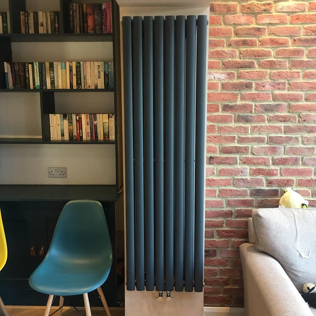 vertical radiator on a brick wall