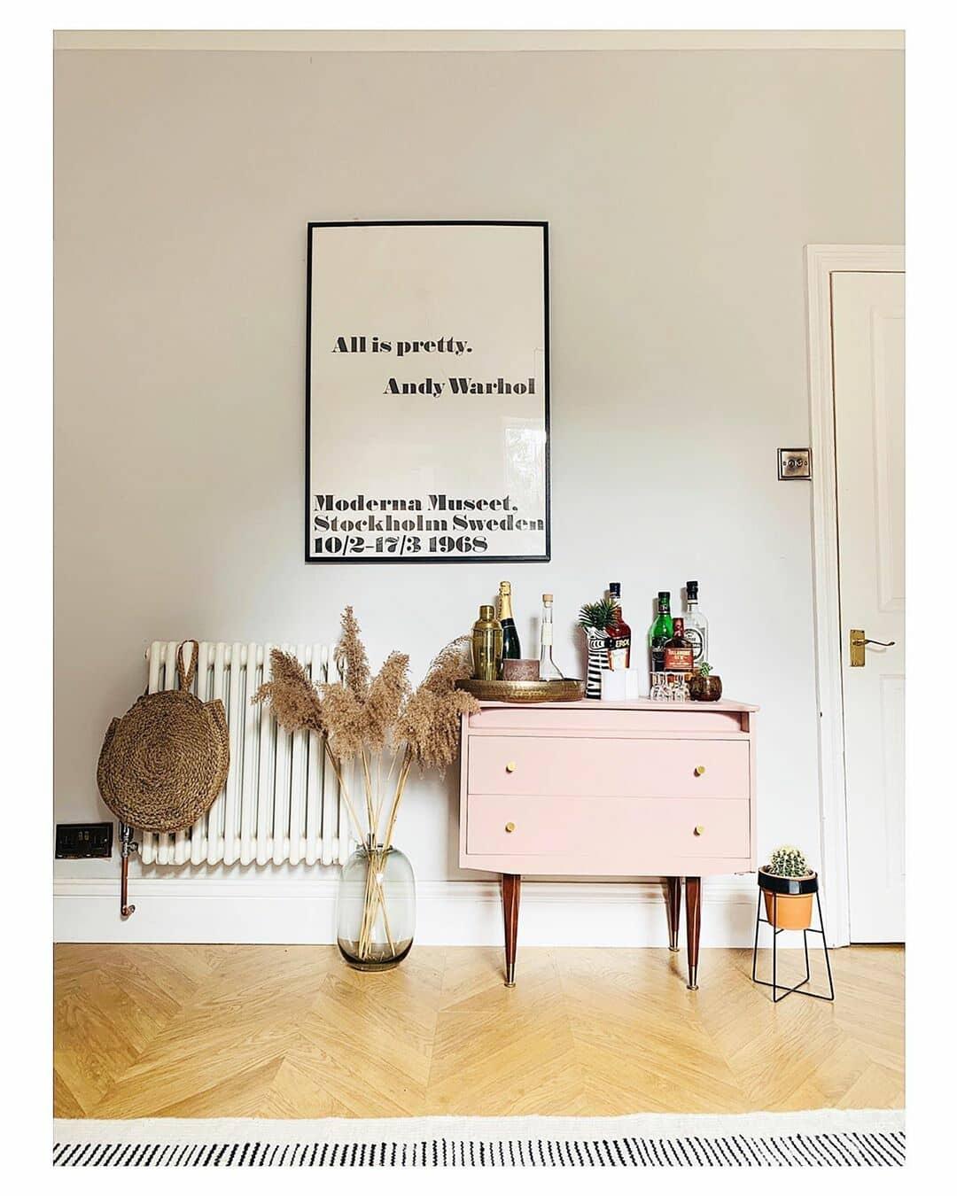 white radiator next to a pink bar cart