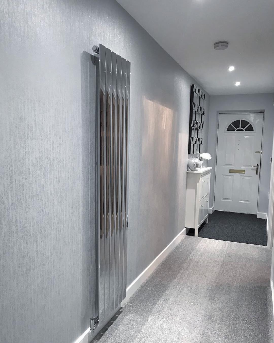 Milano Alpha chrome radiator in a hallway