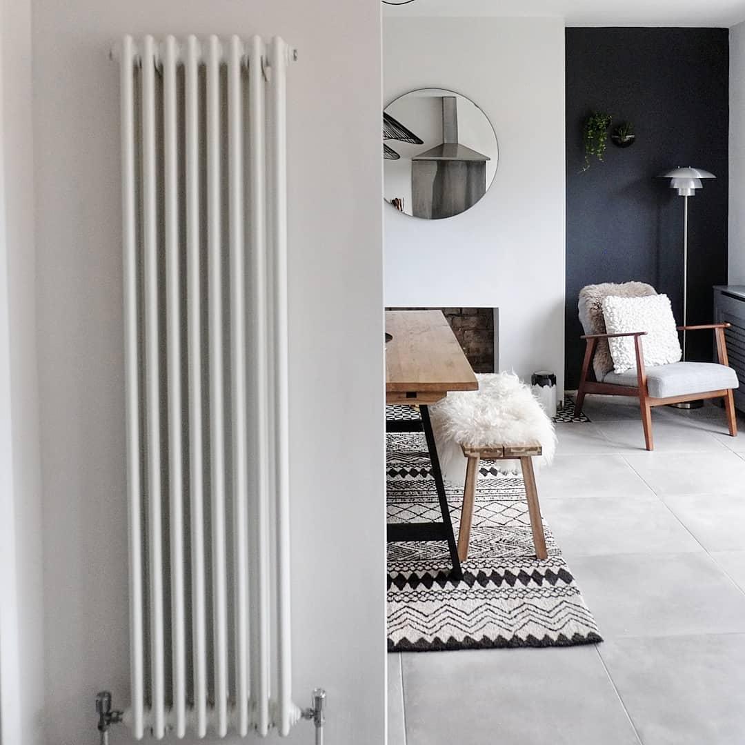 Milano Windsor vertical column radiator in a dining room.