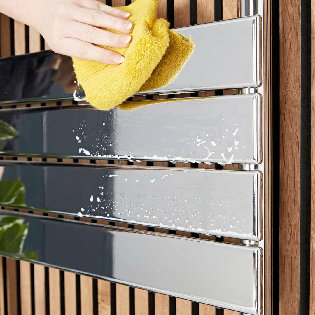 drying a chrome radiator with a cloth