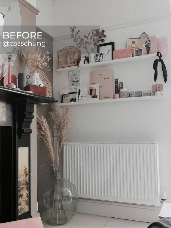 old radiator under a shelf in a bedroom