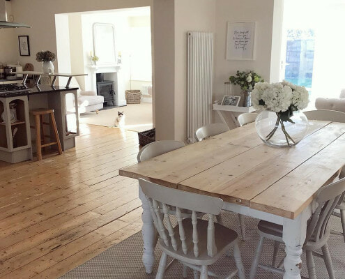 Country style dining room with a column radiator