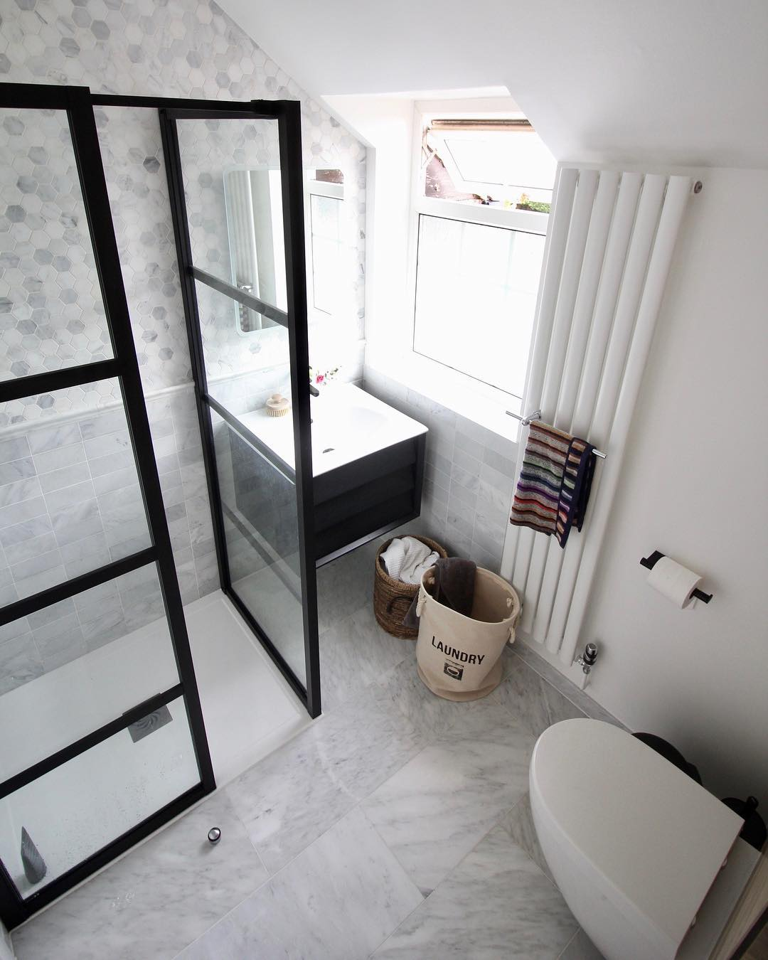 narrow vertical radiator in a small bathroom from above