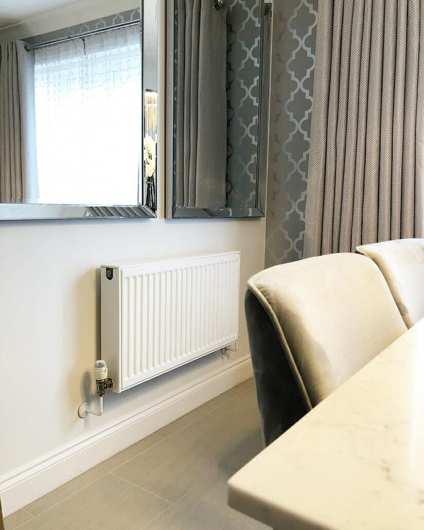 A convector radiator on a white wall.