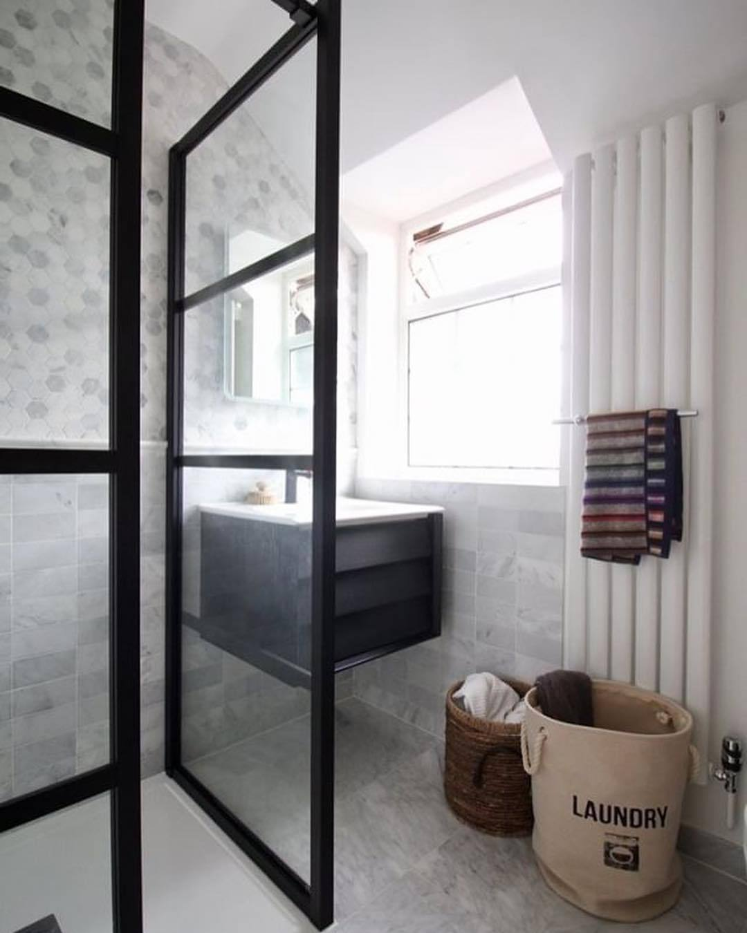 narrow vertical radiator in a small bathroom